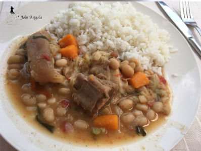 """Rice with """"feijoada"""", a bean and meat stew originating from Portugal and common in all lusophone countries."""